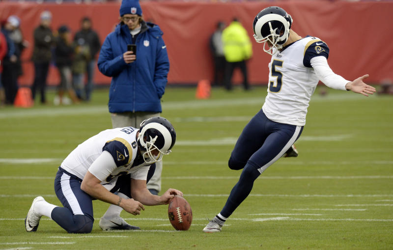 Los Angeles Rams kicker Sam Ficken (5) and holder Johnny Hekker warm up before Ficken's debut against the Titans. (AP)