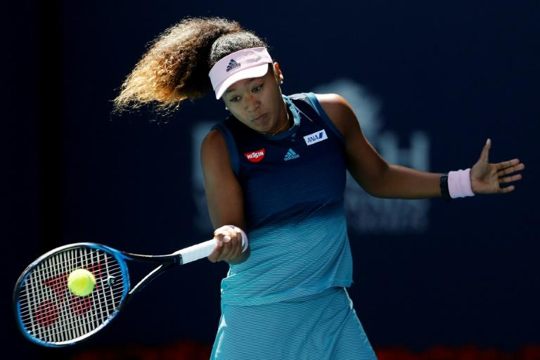 Japan's Naomi Osaka had to keep her emotions in check as she opened her campaign by outlasting Yanina Wickmayer 6-0, 6-7 (3/7), 6-1