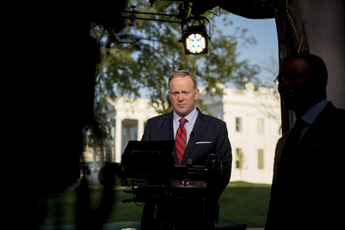"""Sean Spicer prepares to go on cable news on the North Lawn of the White House on April 11. Spicer apologized for making an """"insensitive"""" reference to the Holocaust in earlier comments about Syrian President Bashar Assad's use of chemical weapons. (Photo: Andrew Harnik/AP)"""