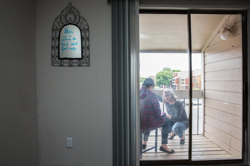 Donna Bloom, director of legal services at Denton County Friends of the Family, visits Amanda at the transitional housing. (Mei-Chun Jau for HuffPost)
