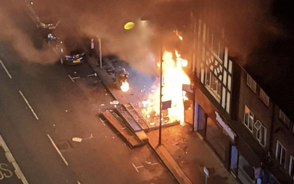 The blaze destroyed the launderette and damaged the flats above it - Twitter