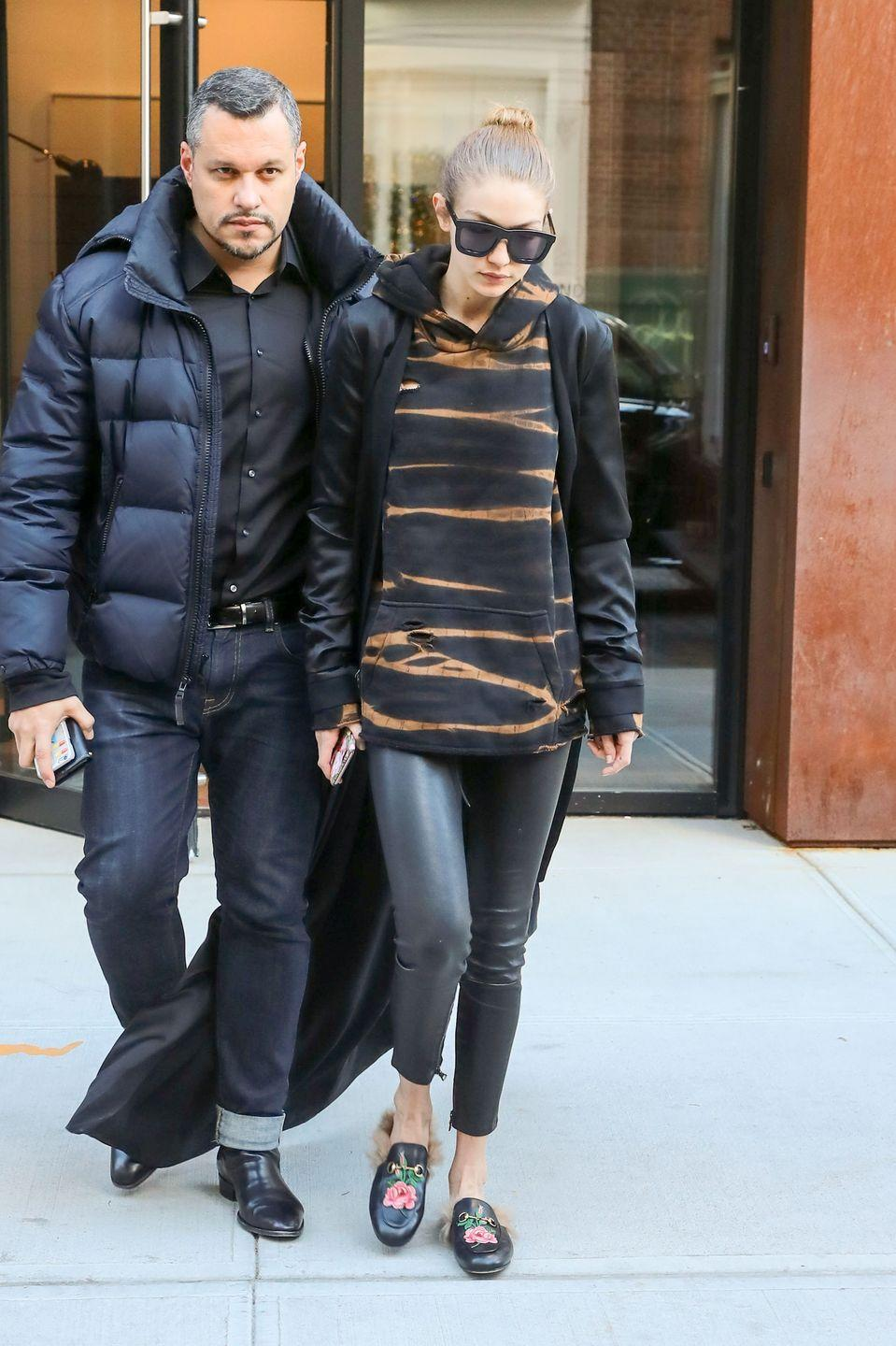 <p>In a black jacket, leather leggings and an orange and black hoodie while out in New York City.</p>
