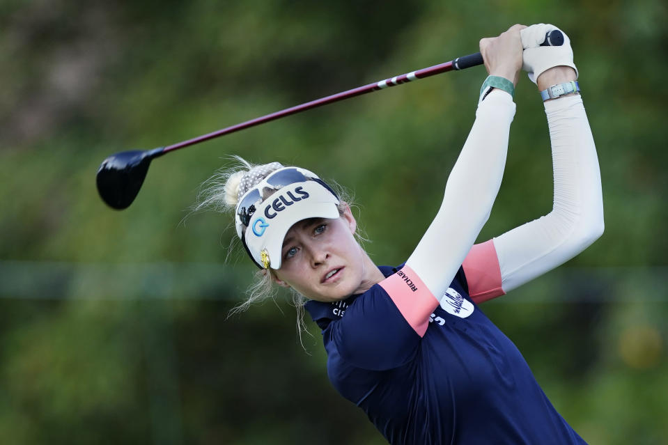 Nelly Korda hits from the tee on the ninth hole during the second round of play in the KPMG Women's PGA Championship golf tournament Friday, June 25, 2021, in Johns Creek, Ga. (AP Photo/John Bazemore)