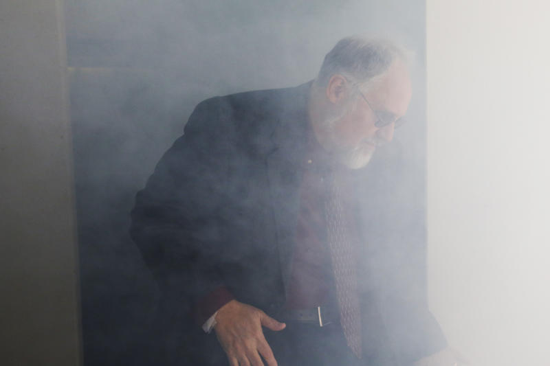 Richard DeWeese, Supervisor of the Aeromedical Engineering Sciences Section at the FAA Civil Aerospace Medical Institute, exits a smoke-filled simulator during a demonstration at the Mike Monroney Aeronautical Center, Thursday, Oct. 17, 2019, in Oklahoma City. Federal researchers, using 720 volunteers in Oklahoma City, will test whether smaller seats and crowded rows slow down airline emergency evacuations. (AP Photo/Sue Ogrocki)