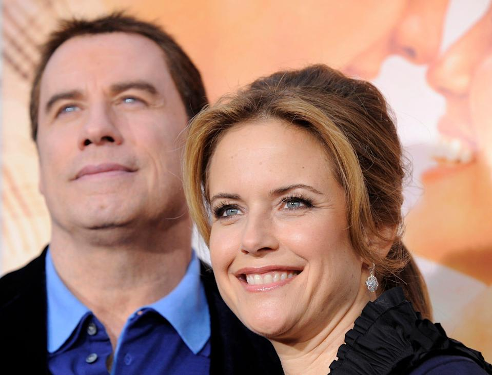 "Kelly Preston and John Travolta attend the premiere of her film ""The Last Song"" in Los Angeles on March 25, 2010."