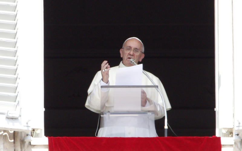 """Pope Francis recites the Angelus prayer from his studio window overlooking St.Peter's Square at the Vatican, Sunday, Sept. 1, 2013. Francis is asking people to join him next weekend in a day of fasting for peace in Syria. The pontiff invited people of all faiths to join him Saturday evening in St. Peter's Square to invoke the """"gift"""" of peace for Syria, the rest of the Middle East and worldwide where there is conflict. (AP Photo/Riccardo De Luca)"""