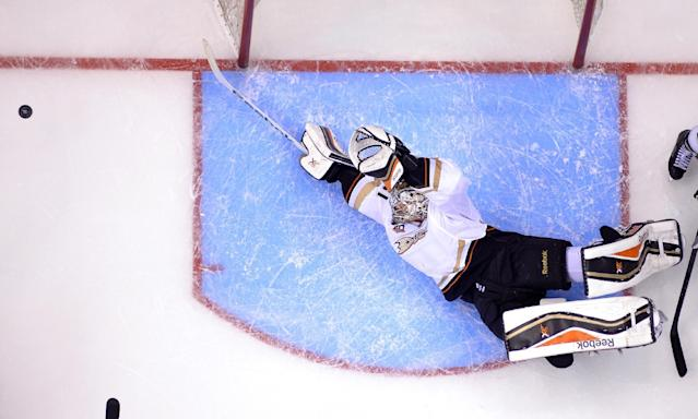 Anaheim Ducks goalie Frederik Andersen, of Denmark, dives to make a save during the third period of Game 3 of an NHL hockey second-round Stanley Cup playoff series against the Los Angeles Kings, Thursday, May 8, 2014, in Los Angeles. The Ducks won 3-2. (AP Photo/Mark J. Terrill)