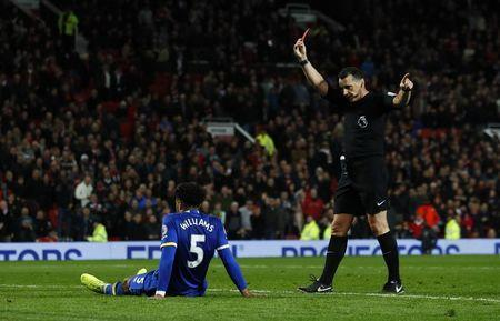 Britain Football Soccer - Manchester United v Everton - Premier League - Old Trafford - 4/4/17 Everton's Ashley Williams is shown a red card by referee Neil Swarbrick Action Images via Reuters / Jason Cairnduff Livepic