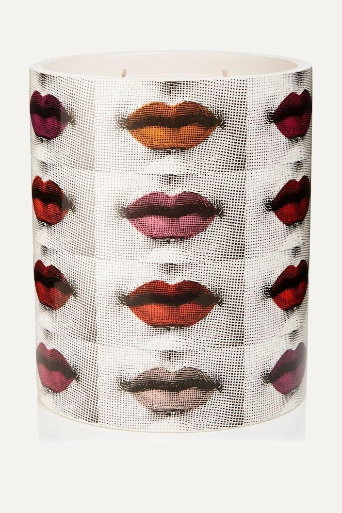 """<p><strong>Fornasetti</strong></p><p>net-a-porter.com</p><p><strong>$365.00</strong></p><p><a href=""""https://go.redirectingat.com?id=74968X1596630&url=https%3A%2F%2Fwww.net-a-porter.com%2Fus%2Fen%2Fproduct%2F1182073&sref=https%3A%2F%2Fwww.townandcountrymag.com%2Fstyle%2Fbeauty-products%2Fg19408606%2Fgift-ideas-for-women%2F"""" rel=""""nofollow noopener"""" target=""""_blank"""" data-ylk=""""slk:Shop Now"""" class=""""link rapid-noclick-resp"""">Shop Now</a></p><p>Is there anything more stylish than a Fornasetti candle on one's bookshelf? No. Besides the ceramic vessel will be a piece of decor even after the lily of the valley, sandal, iris, and orange blossom candle has burned all the way down. </p>"""