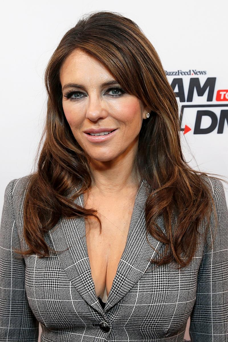 Elizabeth Hurley, 54, shows off her figure in striped bikini: 'Just like a fine wine'