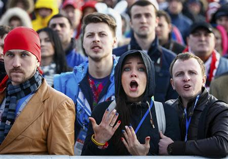 Russian fans react as they watch a broadcast of the ice hockey quarter-final match between Russia and Finland in the Olympic Park during the 2014 Winter Olympic Games