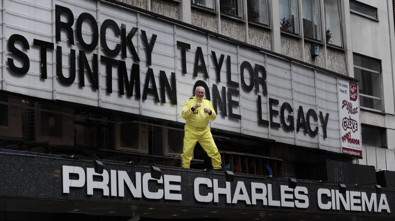 British stuntman Rocky Taylor, aged 64, poses above the entrance of the Prince Charles Cinema in central London. (Credit: PA)