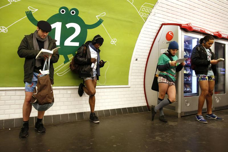 "Passengers without their pants wait for a train during the ""No Pants Subway Ride"" event at a subway station in Paris"