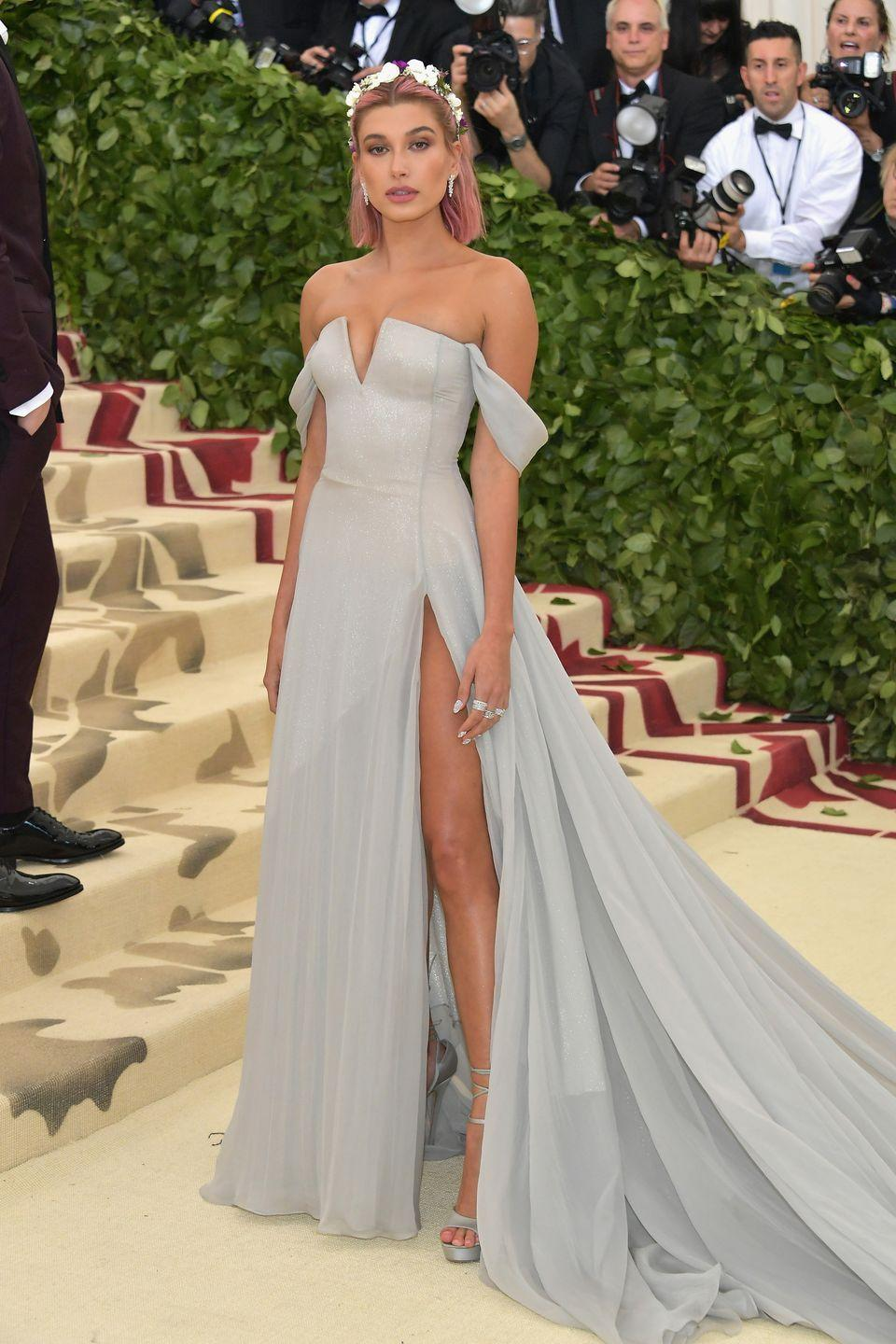 <p>American model Hailey Bieber channeled Princess Aurora in an icy-blue off-the-shoulder gown by Tommy Hilfiger at the 2018 Met Gala in New York.</p>