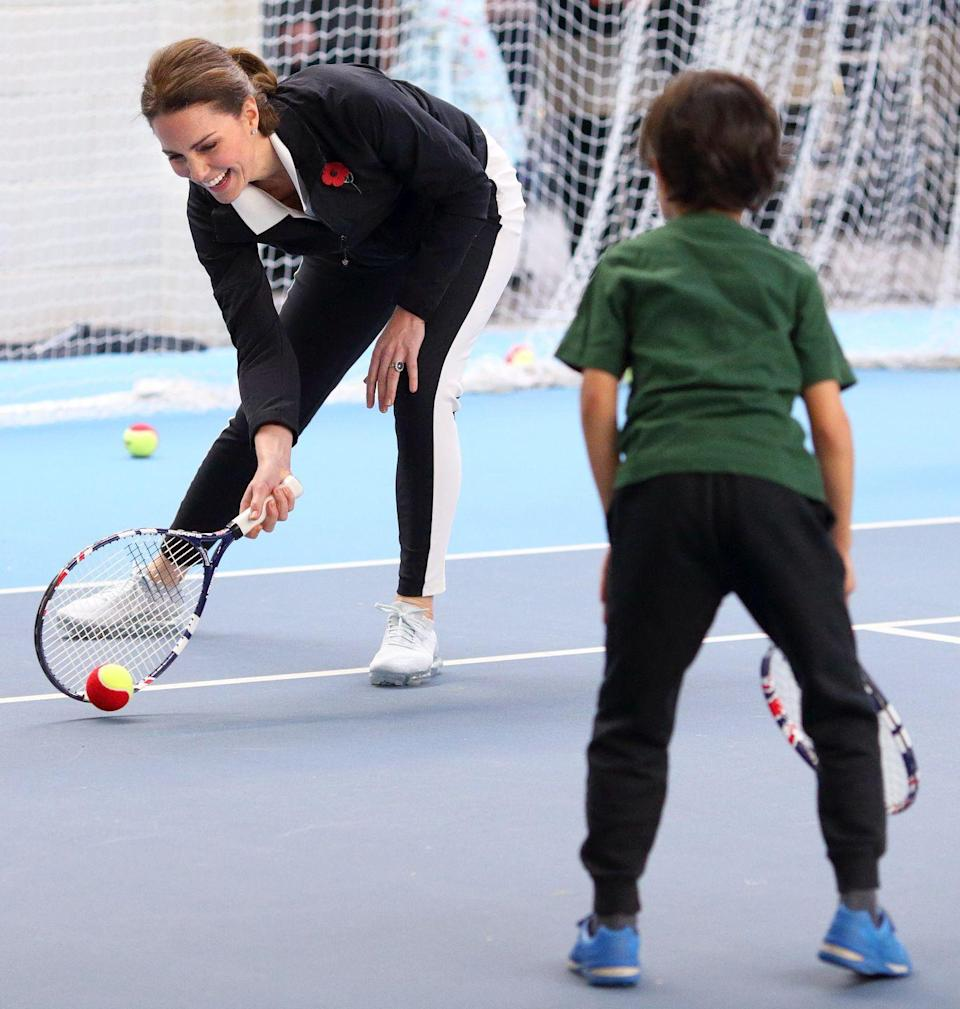 <p>In 2016, Kate took over from the Queen as the royal patron of the Lawn Tennis Association . Here, she embraces her new position by playing around with kids at the National Tennis Centre. </p>