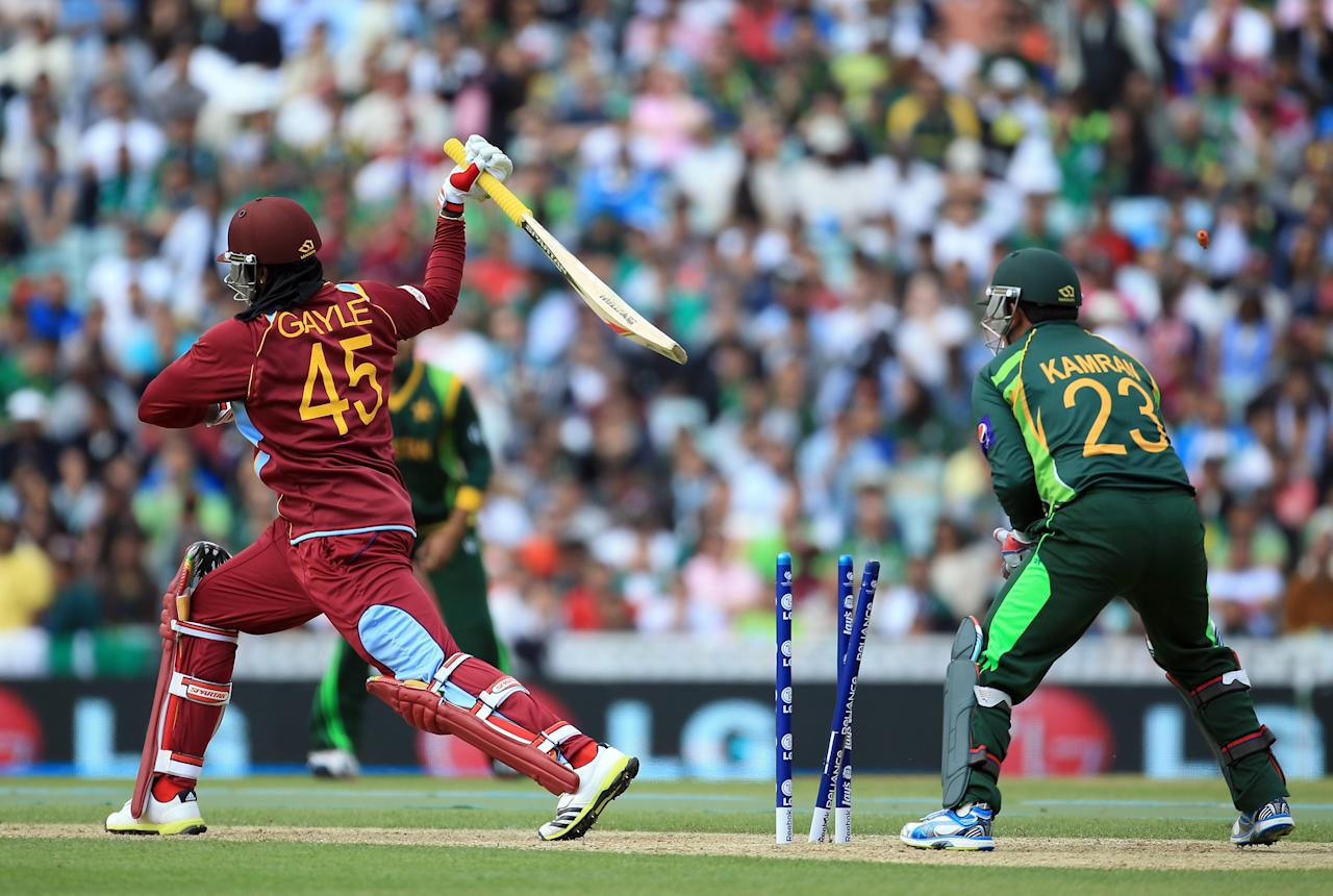 LONDON, ENGLAND - JUNE 07:  Chris Gayle of West Indies is bowled out during the ICC Champions Trophy group B match between West Indies and Pakistan at The Oval on June 7, 2013 in London, England.  (Photo by Richard Heathcote/Getty Images)