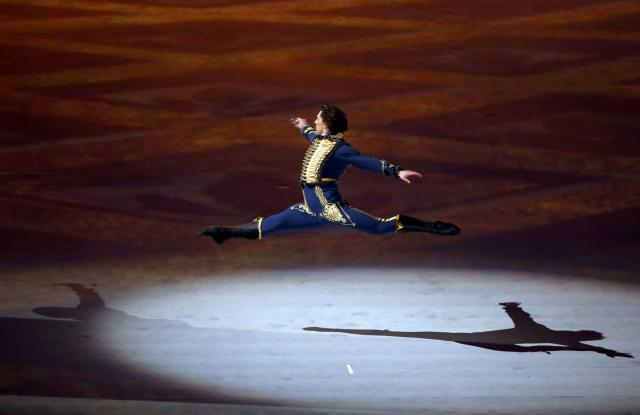 Ballet dancer Danila Korusntsev takes part in the opening ceremony of the 2014 Sochi Winter Olympics, February 7, 2014. REUTERS/Lucy Nicholson (RUSSIA - Tags: OLYMPICS SPORT)