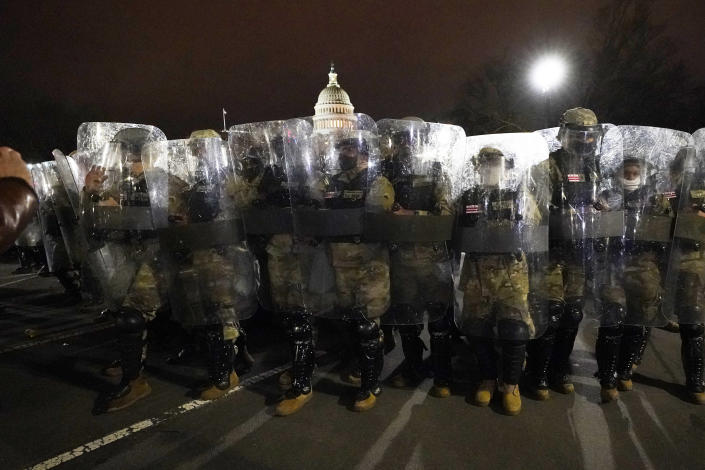 DC National Guard stand outside the Capitol, Wednesday, Jan. 6, 2021, after a day of rioting protesters. (AP Photo/Julio Cortez)
