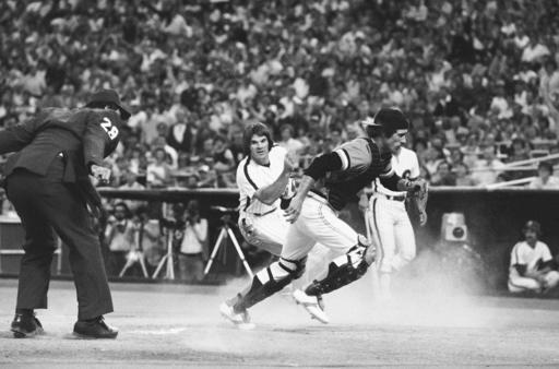 FILE - In this July 1979 file photo, Philadelphia Phillies' Pete Rose turns as he crosses the plate to watch San Francisco Giants catcher Mike Sadek chase down the ball that went by him in the first inning of a baseball game in Philadelphia. Rose had scored from second base on a teammate's single. Sadek, a popular backup catcher who played all eight of his major league seasons with the Giants, has died. He was 74. The team announced Sadek died Wednesday, Jan. 20, 2021, in San Andreas, Calif., following a short illness. (AP Photo/Rusty Kennedy, File)
