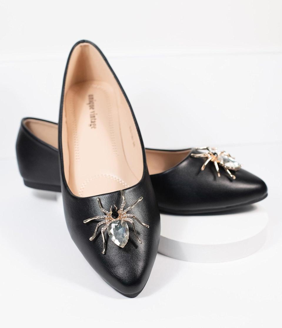 <p>You'll give everyone the creeps in these <span>Unique Vintage Black Spider Evie Flats</span> ($56).</p>
