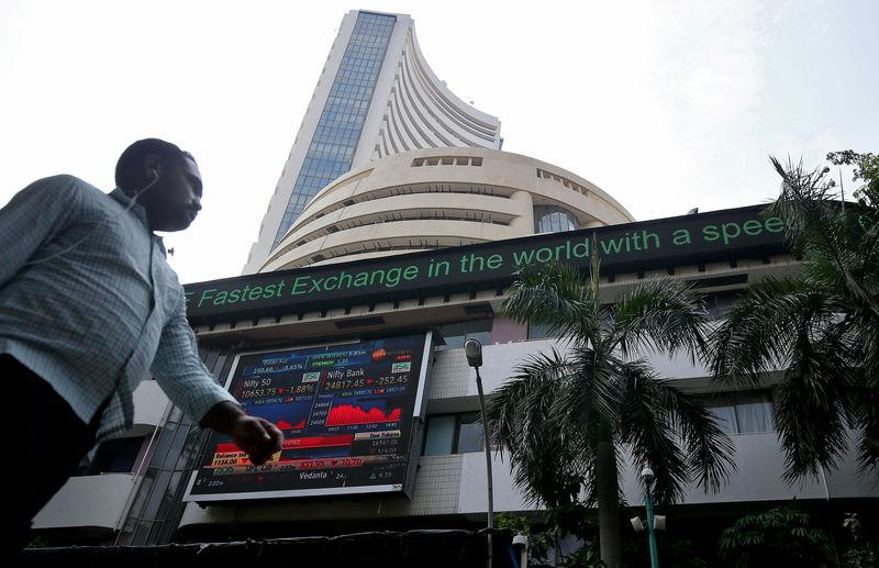 A man walks past the Bombay Stock Exchange (BSE) building in Mumbai