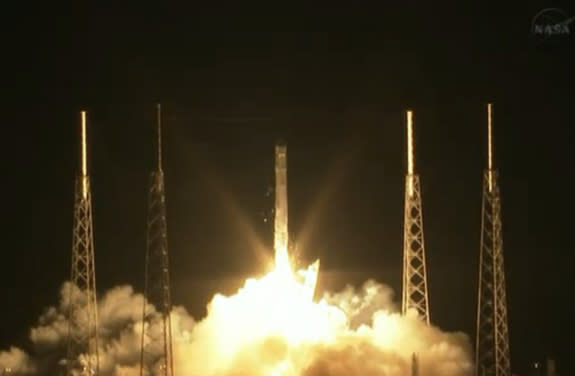 SpaceX's unmanned Dragon capsule launches toward the International Space Station on the first-ever bona fide cargo run for a private American spaceship.