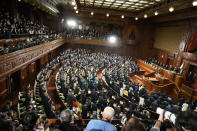 Lawmakers listen to the announcement of the dissolution of the lower house Thursday, Oct. 14, 2021, in Tokyo. Japan's new Prime Minister Fumio Kishida dissolved the lower house of parliament Thursday, paving the way for Oct. 31 national elections.(AP Photo/Eugene Hoshiko)