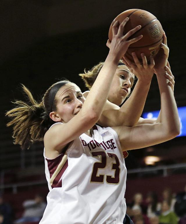 Boston College guard Kelly Hughes (23) battles for a rebound with Maryland Terrapins guard Katie Rutan (40) during the first half of an NCAA college basketball game, Thursday, Feb. 27, 2014, in Boston. (AP Photo/Charles Krupa)