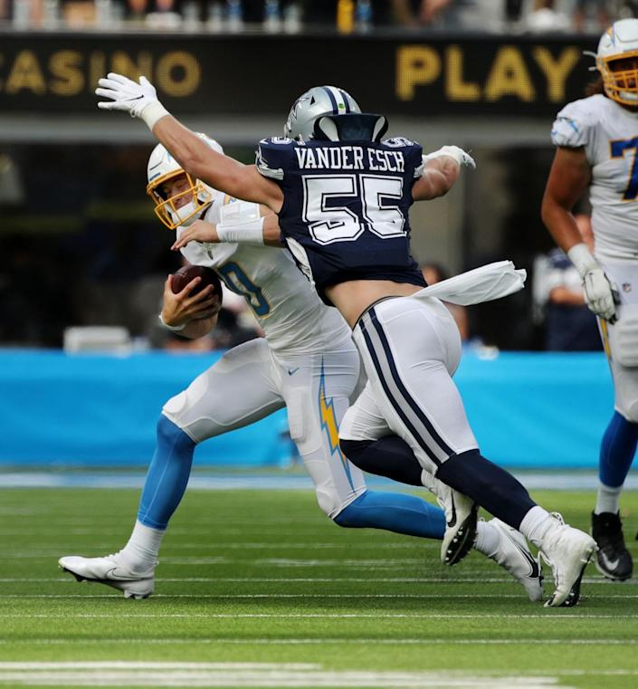 Chargers quarterback Justin Herbert is chased and sacked by Dallas Cowboys outside linebacker Leighton Vander Esch.