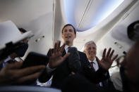 U.S. President Donald Trump's senior adviser Jared Kushner, center, stands with U.S. National Security Advisor Robert O'Brien while speaking to journalists during a flight on an Israeli El Al plane to Abu Dhabi, United Arab Emirates, Monday, Aug. 31, 2020. The plane landed in Abu Dhabi after flying in from Israel in the first-ever direct commercial passenger flight to the United Arab Emirates. (Nir Elias/Pool Photo via AP)