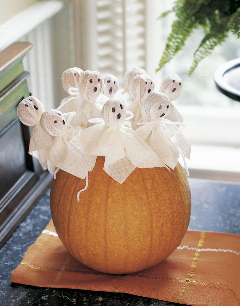 <p>Fill your hollowed-out gourd with dressed-up lollipops. It'll double as cute decor and a handy trick-or-treating bowl.</p>