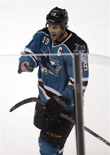 San Jose Sharks center Joe Thornton (19) smiles after the Sharks game against the Columbus Blue Jackets in an NHL hockey game in San Jose, Calif., Tuesday, Jan. 31, 2012. The Sharks defeated the Jackets 6-0. Thornton scored twice during the game. (AP Photo/Paul Sakuma)