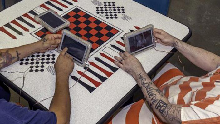Inmates take part in the SecureView Tablet program