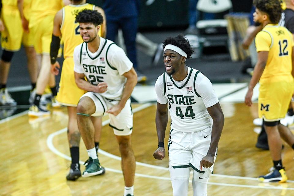 Michigan State's Gabe Brown, right, and Malik Hall celebrate after beating Michigan 70-64 on Sunday, March 7, 2021, at the Breslin Center in East Lansing.