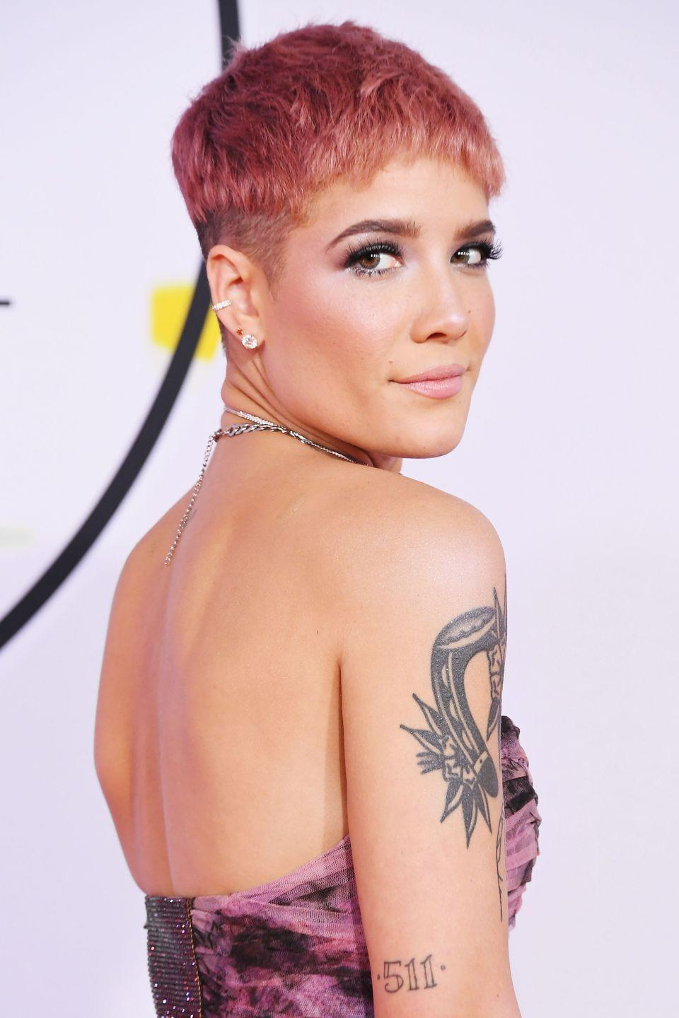 """<p><strong>Born</strong>: Ashley Frangipane</p><p>Although fans have long speculated that Halsey created her stage name as an anagram of her first name, Ashley, she was actually inspired by a street in Brooklyn. In an <a href=""""https://www.youtube.com/watch?v=cUG8VDYy7CY"""" rel=""""nofollow noopener"""" target=""""_blank"""" data-ylk=""""slk:interview for Vevo"""" class=""""link rapid-noclick-resp"""">interview for Vevo</a>, the singer revealed that a friend of hers lived on Halsey Street, and she spent her weekends away from her New Jersey hometown there making music.</p>"""
