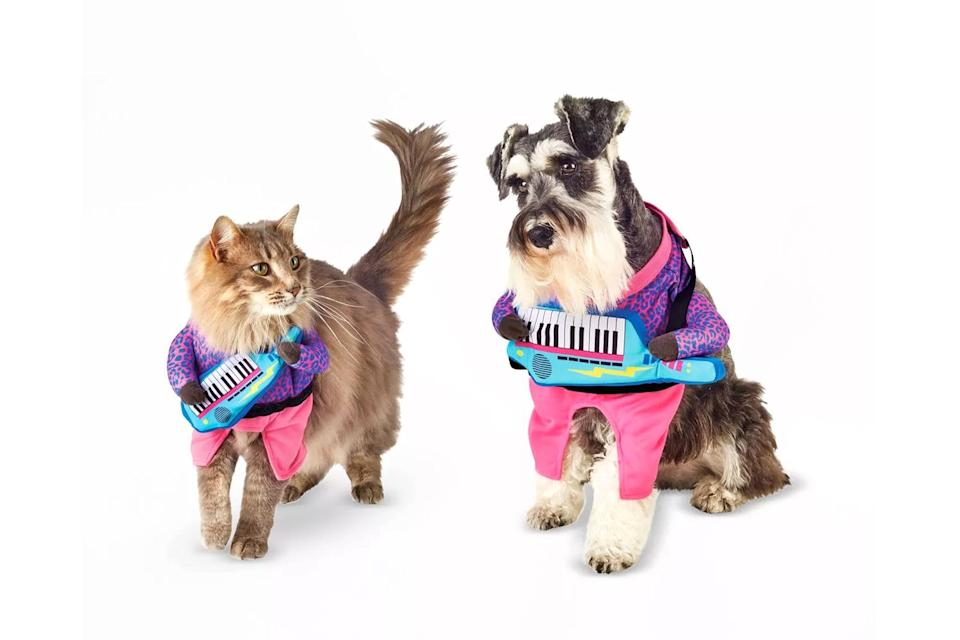 """<p>Hair metal is making a comeback thanks to these cute costumes for furry music fans. </p> <p><strong>Buy it!</strong> Keyboard Guitarist Frontal Dog and Cat Costume, $10.00; <a href=""""https://goto.target.com/c/249354/81938/2092?subId1=PEO25HalloweenCostumesforDogsthatWillHaveTrickorTreatersHowlingwithJoykbender1271PetGal12909733202109I&u=https%3A%2F%2Fwww.target.com%2Fp%2Fkeyboard-guitarist-frontal-dog-and-cat-costume-hyde-eek-boutique%2F-%2FA-82325146"""" rel=""""sponsored noopener"""" target=""""_blank"""" data-ylk=""""slk:Target.com"""" class=""""link rapid-noclick-resp"""">Target.com</a></p>"""