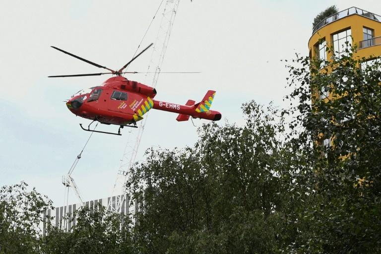 The boy fell from a viewing platform onto a fifthfloor roof and was airlifted to hospital by helicopter (AFP Photo/Daniel SORABJI)