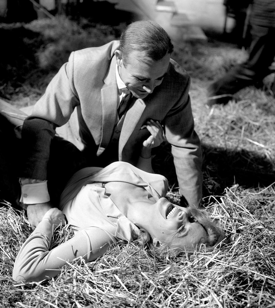 File photo dated 02/06/64 of Pussy Galore. played by Honor Blackman, submitting to James Bond, played by Sean Connery, in this scene from 'Goldfinger', during filming at Pinewood Studios. Former James Bond actor Sir Sean Connery has died aged 90, his family have told the BBC.