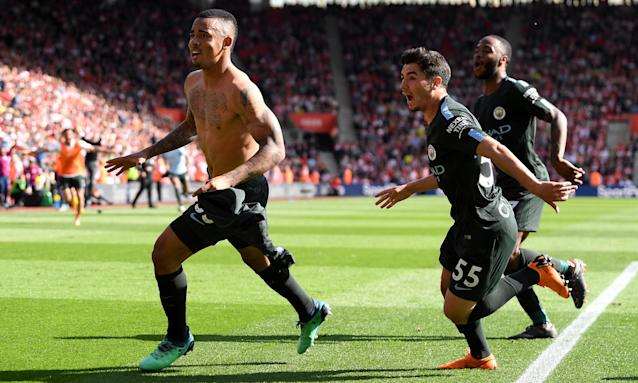 Gabriel Jesus, left, leads the celebratory charge after scoring the late goal that took Manchester City to 100 points and a 1-0 win over Southampton.