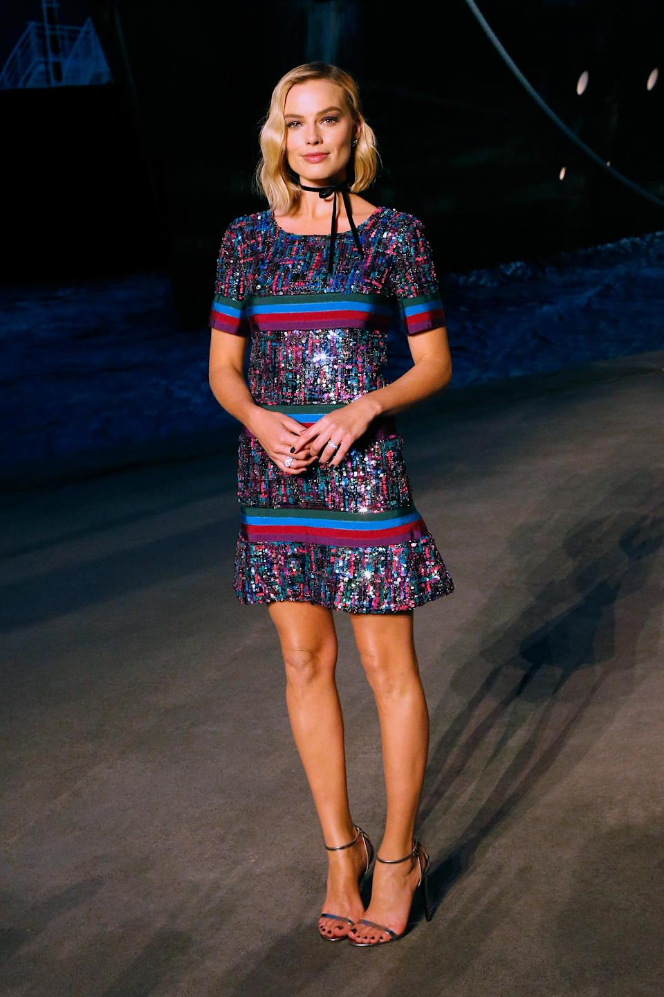 <p>Margot's first fashion show as a Chanel ambassador saw her wearing a Chanel Pre-Fall 2018 dress, which she accessoried with a dainty black ribbon around her neck. We'll be trying this… <br><em>[Photo: Getty]</em> </p>