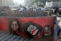 Security forces are deployed at anti-government protesters' site to remove protesters' tents in Tahrir Square, Baghdad, Iraq, Saturday, Oct. 31, 2020. (AP Photo/Khalid Mohammed)