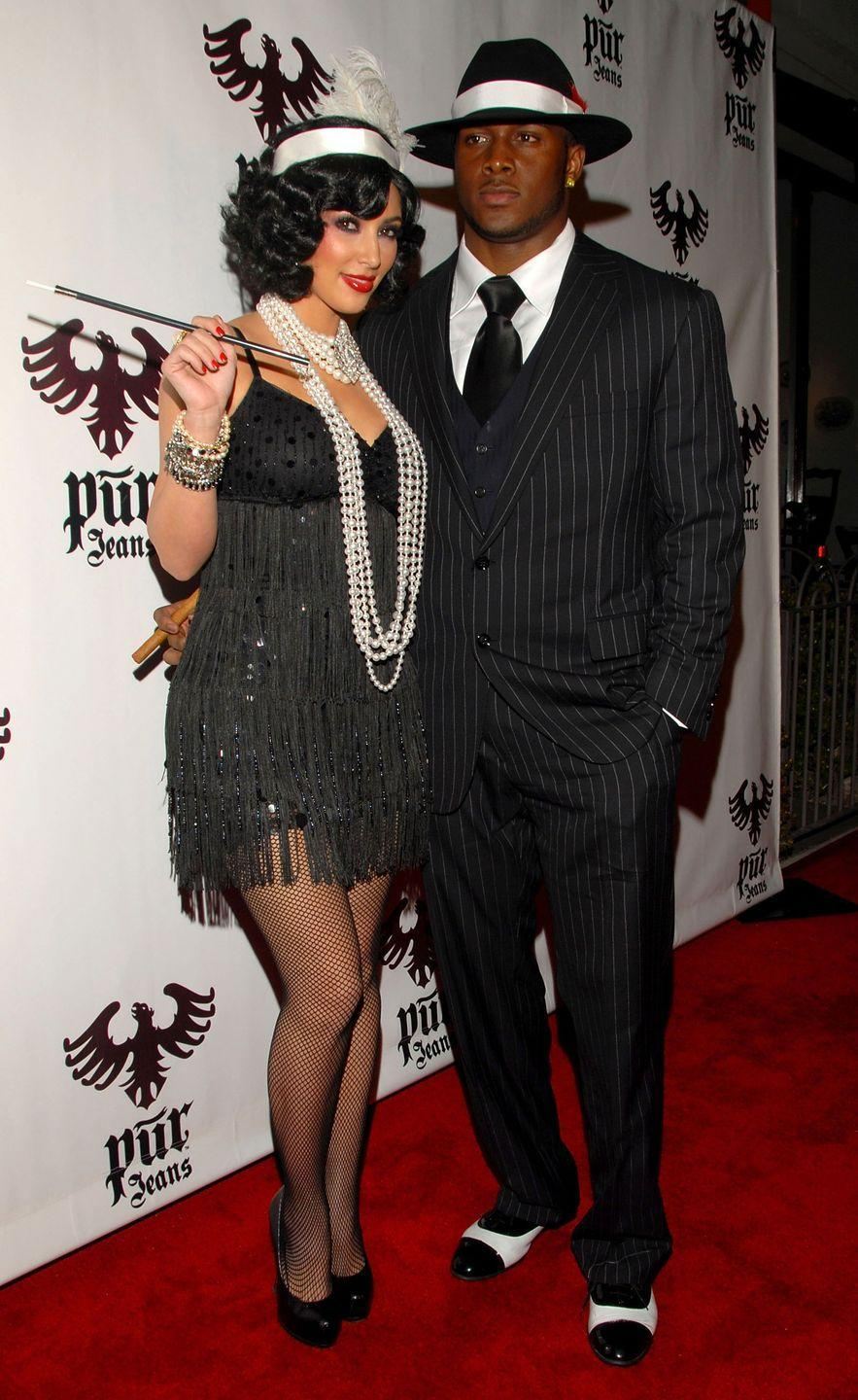 <p>Throwback—times two! Kim K. donned the 1920s flatter getup in 2008, back when she was still with former football player Reggie Bush (who dressed up as a matching mobster).</p>