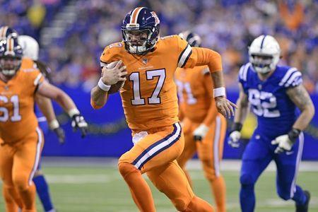 Dec 14, 2017; Indianapolis, IN, USA; Denver Broncos quarterback Brock Osweiler (17) runs towards the end zone in the second quarter against the Indianapolis Colts at Lucas Oil Stadium. Mandatory Credit: Thomas J. Russo-USA TODAY Sports