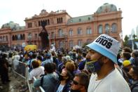 People line up for the wake of soccer legend Diego Maradona at the presidential palace Casa Rosada, in Buenos Aires