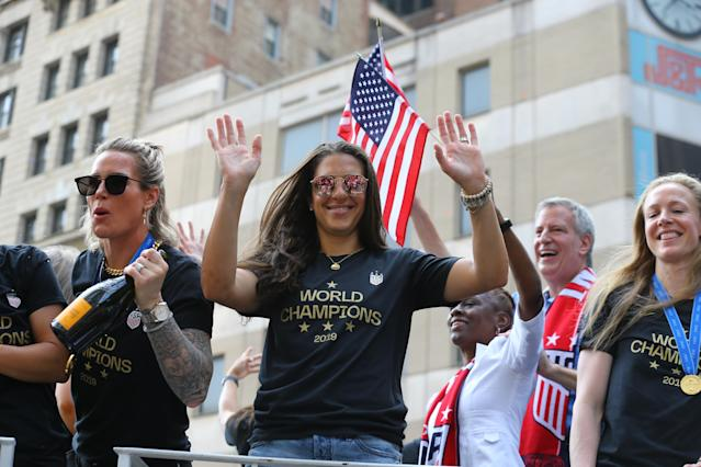Alex Morgan acknowledges the crowds as the U.S. women's soccer team is celebrated with a parade along the Canyon of Heroes, Wednesday, July 10, 2019, in New York. (Photo: Gordon Donovan/Yahoo News)