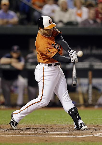 Baltimore Orioles' Steve Pearce doubles in the second inning of a baseball game against the Boston Red Sox, Saturday, Sept. 28, 2013, in Baltimore. Nick Markakis scored on the play. (AP Photo/Patrick Semansky)