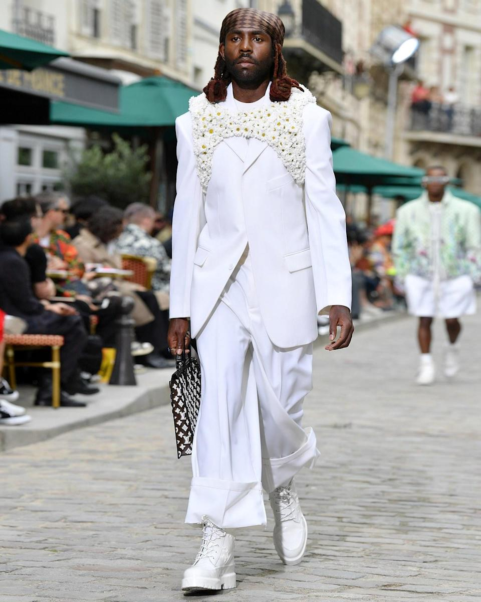"""<h1 class=""""title"""">June 20: Dev Hynes</h1> <div class=""""caption""""> Dev Hynes looking positively angelic on the runway for the Louis Vuitton S/S 20 show. </div> <cite class=""""credit"""">Getty Images</cite>"""