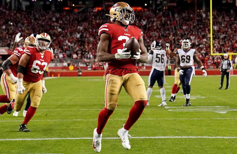 Running back Raheem Mostert scores a touchdown for the San Francisco 49ers against the Rams. (Photo by Thearon W. Henderson/Getty Images)