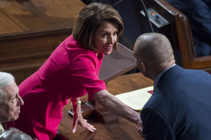 Speaker of the House Nancy Pelosi, D-Calif., talks with Rep. Hakeem Jeffries, D-N.Y., before she won the speakership in the Capitol's House chamber on the first day of the 116th Congress on January 3, 2019. (Tom Williams/CQ Roll Call via Getty Images)