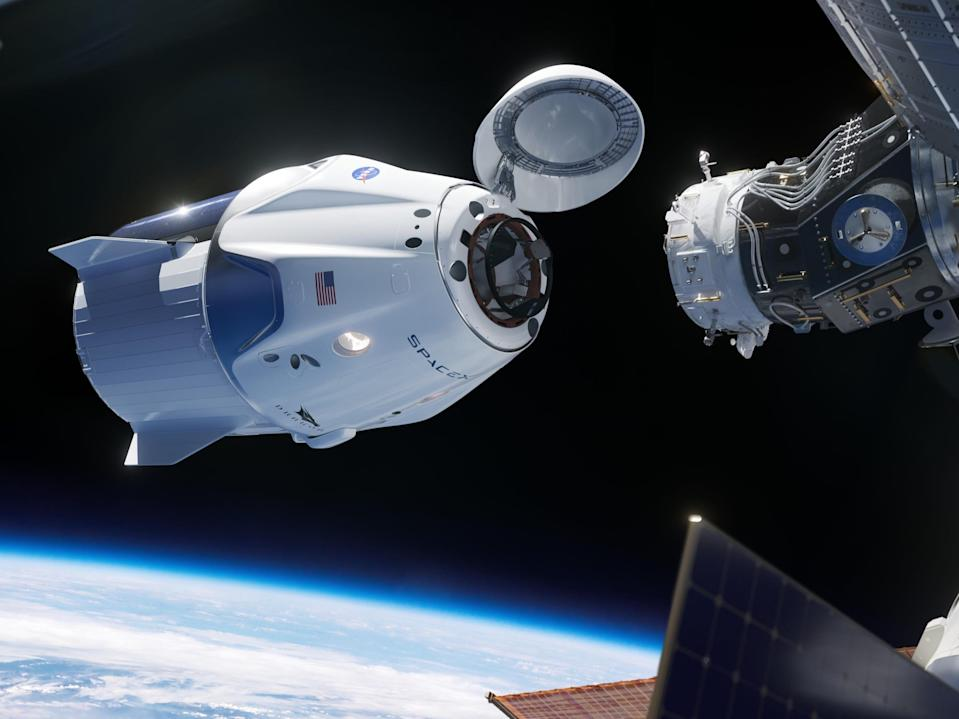 An illustration of Crew Dragon docking with the International Space Station.